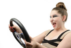 Young girl with a steering wheel Royalty Free Stock Image