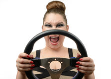 Young girl with a steering wheel on white Stock Image