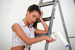 Young girl on a stepladder Royalty Free Stock Images