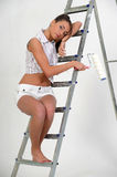 Young girl on a stepladder Stock Photos