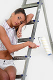 Young girl on a stepladder Stock Photo