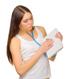 Young girl with stethoscope and laptop Stock Photos