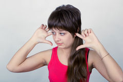 Young girl stopped up their ears Royalty Free Stock Photo