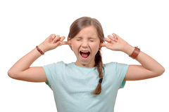 Young girl stops his ears with his hands and Stock Images