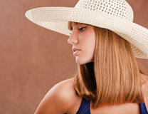 Young girl in a straw hat Royalty Free Stock Photos
