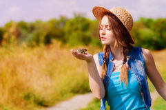 Young girl in a straw hat Royalty Free Stock Photo