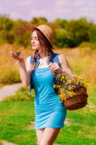 Young girl in a straw hat Royalty Free Stock Image