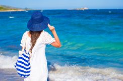 Young girl with  straw hat and blue stripy bag at Stock Photo