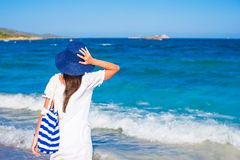 Young girl with  straw hat and blue stripy bag at Royalty Free Stock Photos