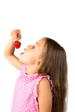 Young Girl with a Strawberry Stock Photo