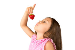 Young Girl with a Strawberry Stock Image