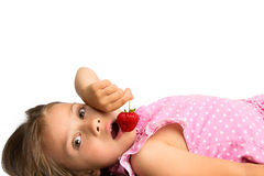 Young Girl with a Strawberry Royalty Free Stock Image