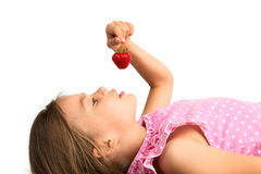 Young Girl with a Strawberry Royalty Free Stock Images