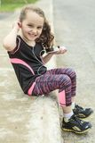 Young girl street jogging Stock Images
