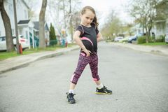 Young girl street jogging Stock Photos