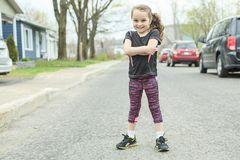 Young girl street jogging Royalty Free Stock Image