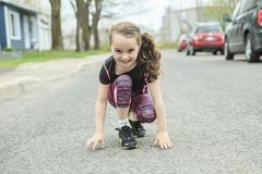 Young girl street jogging Royalty Free Stock Images