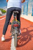 Young girl riding a bike on the street stock photography