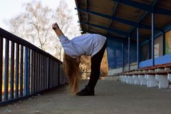 Young girl stretches Stock Image