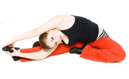 A young girl stretching Royalty Free Stock Photos