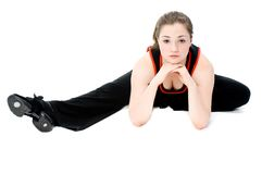 Young Girl Stretching. A young caucasian girl doing different stretches royalty free stock photo