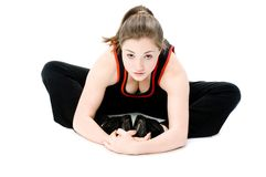 Young Girl Stretching. A young caucasian girl doing different stretches stock photos