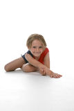 Young girl stretching. Her arm against a high key background Stock Image