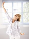 Young girl stretching in the morning in pyjama Stock Photography
