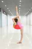 Young girl stretching out indoor Royalty Free Stock Image