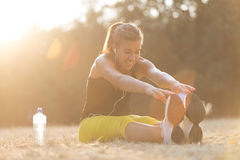 Young girl stretching after workout Royalty Free Stock Photography