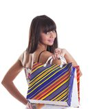 Young girl with striped bags on spine look at you Stock Photo