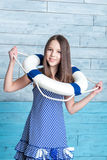 Young girl in a striped dress dressed lifeline royalty free stock photos