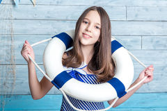 Young girl in a striped dress dressed lifeline royalty free stock images