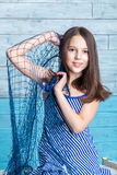 Young girl in striped dress with marine network royalty free stock photos