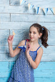 Young girl in striped dress with marine network stock image