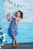 Young girl in striped dress with marine network Royalty Free Stock Image