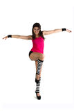 A young girl in striped stockings exercise of yoga Royalty Free Stock Photos