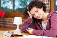 Young girl struggeling with homework. Stock Image
