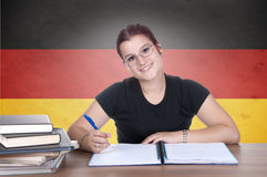 Young girl student on the background with germanl flag Stock Photography