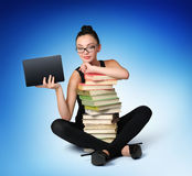 Young girl student with books and electronic table. T future on deep blue background, concept Stock Photo
