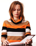 Young girl student with folder sitting at the desk Stock Photography
