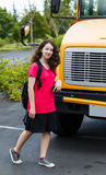 Young Girl Student Leaving School Bus Stock Photo