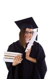Young girl in student mantle with diploma and stack of books Stock Photos