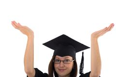 Young girl in student mantle indicates hand Stock Image
