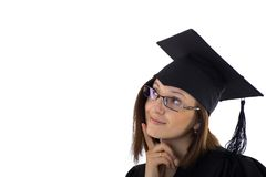 Young girl in student mantle looking dreamily Royalty Free Stock Photos