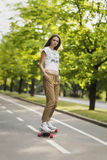 Young girl student model pants shirt and sneakers rides on the b stock image