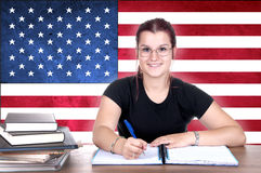 Young girl student pc on the background with american flag Stock Photo