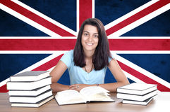 Young girl student pc on the background with UK flag Royalty Free Stock Image