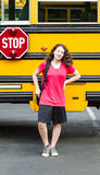 Young Girl Student Standing next to side of Bus Royalty Free Stock Images