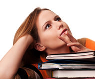Young Girl Student With Pile Of Books Dreaming Royalty Free Stock Image